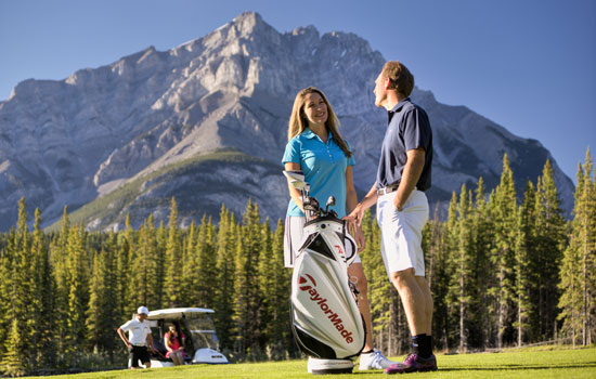 Couple golfing in Banff