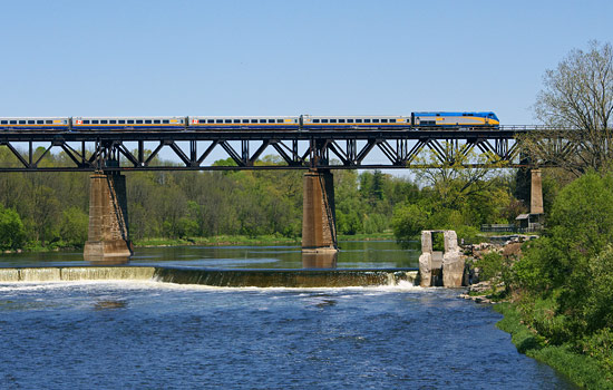 The 'Corridor' train travels on a bridge over a river