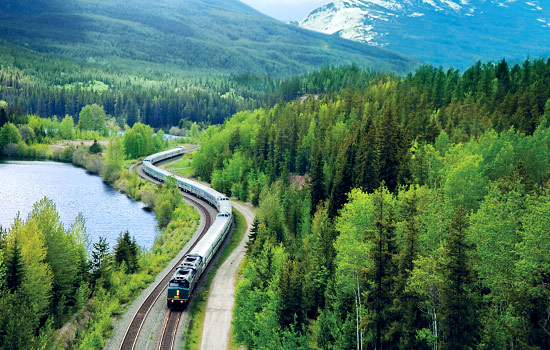 The VIA Rail train travels through the Canadian Rockies