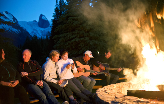 Relax, after adventure filled days, sharing stories around a roaring fire.