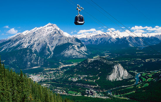 A gondola ride high above Banff with views over Cascade Mountain and the Rockies