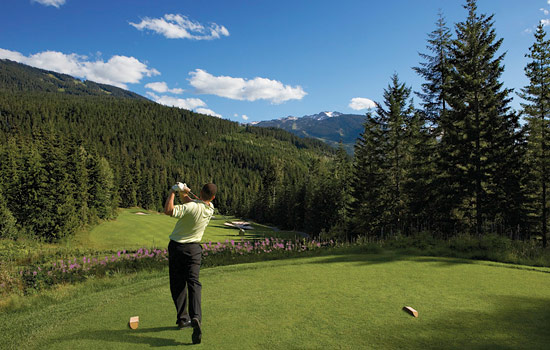 A solo golfer plays with views of mountains and wild flowers in Whistler