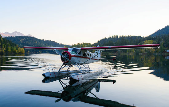 A float plane lands in a lake at the Great Bear Lodge