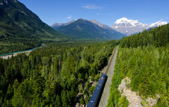 The Rocky Mountaineer travels through a mountain valley