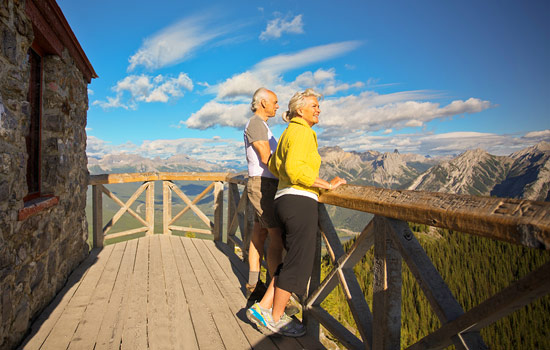 Couple looking out over the Canadian Rockies