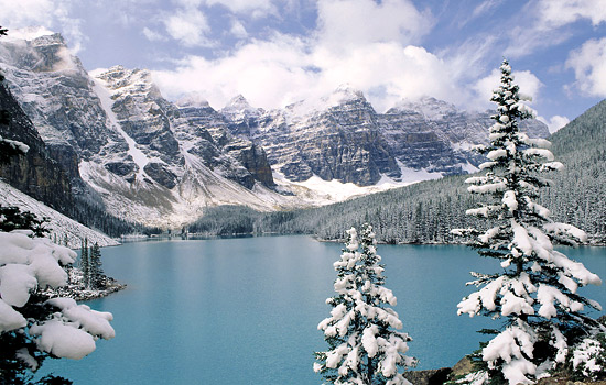 A winter scene in the Rockies of a snow covered Moraine Lake