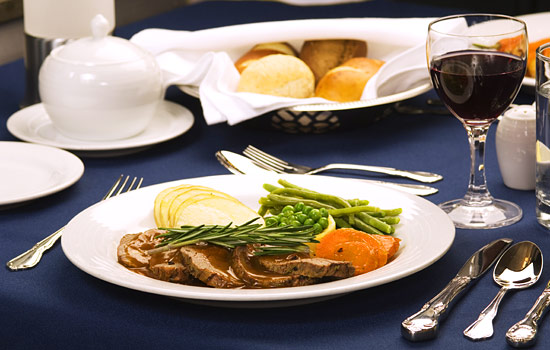 Onboard dinner of roast beef with red wine